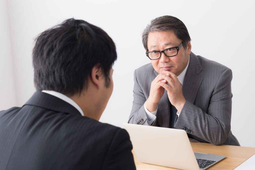 Japanese worker talking with boss