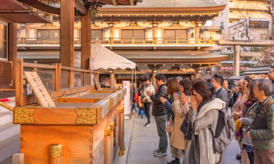 Praying at Japanese Shrine