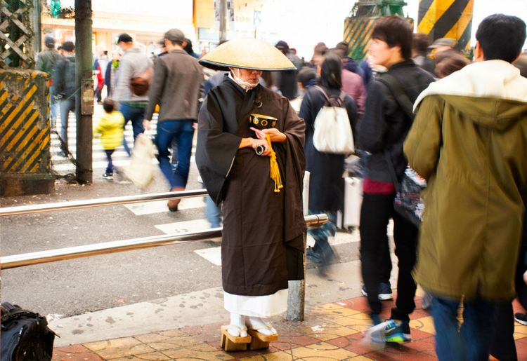 Japan Monk by Busy Crosswalk