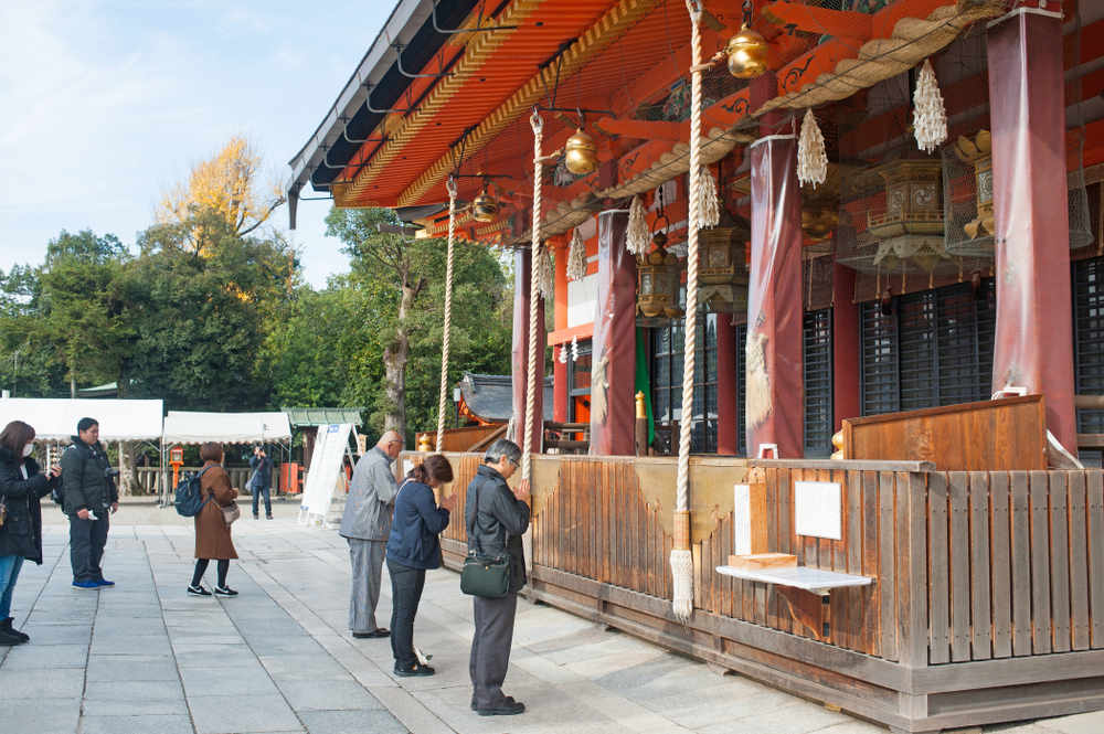 Praying at Yasaka Shrine