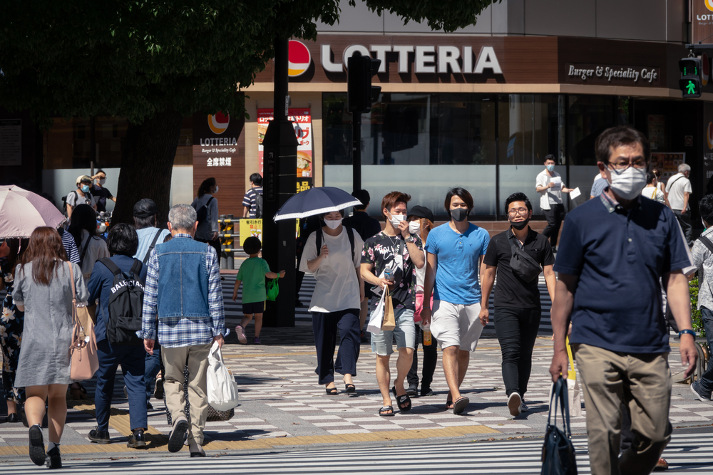people walking with masks in tokyo