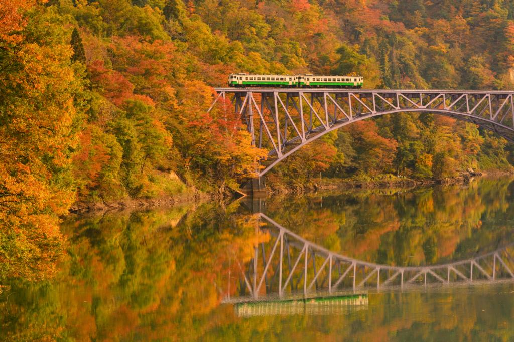 Tadami Line running on a railroad bridge