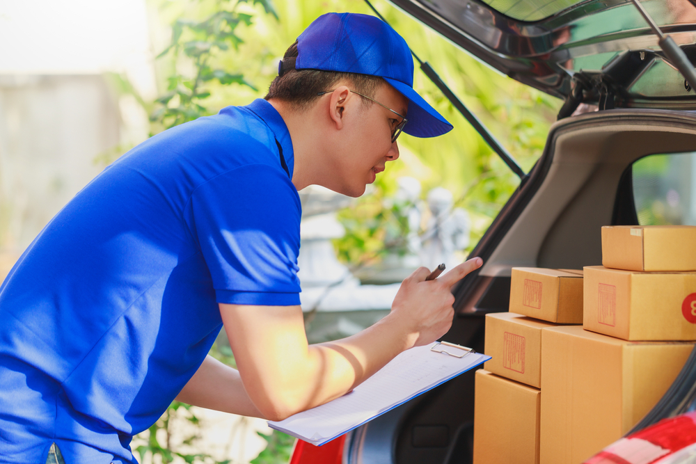 Delivery worker checking packages