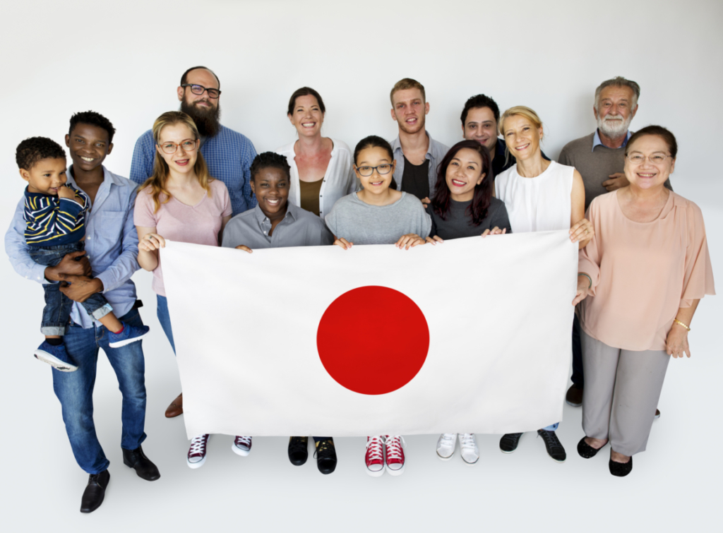 Smiling international group holding Japanese flag