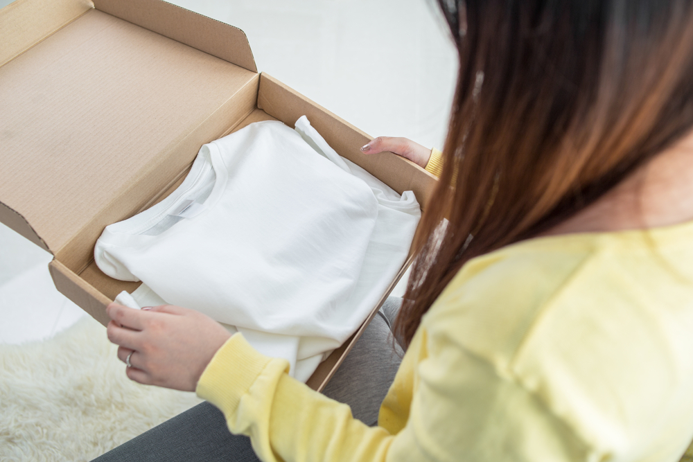 Woman packing a shirt
