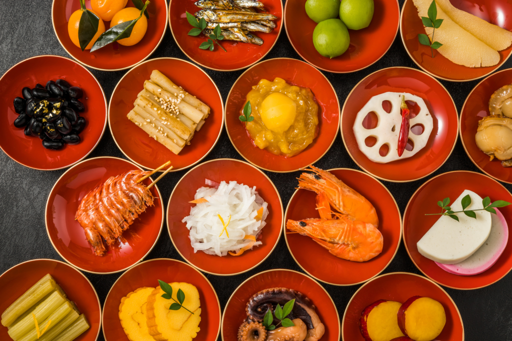 an array of osechi dishes