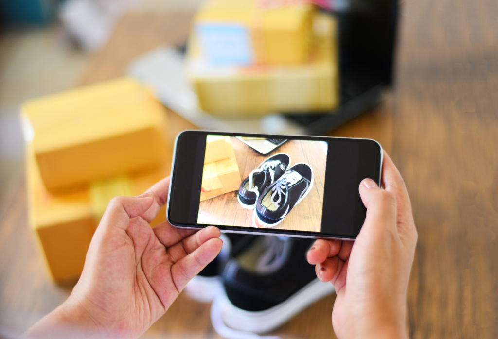 Person taking picture of sneakers with smartphone