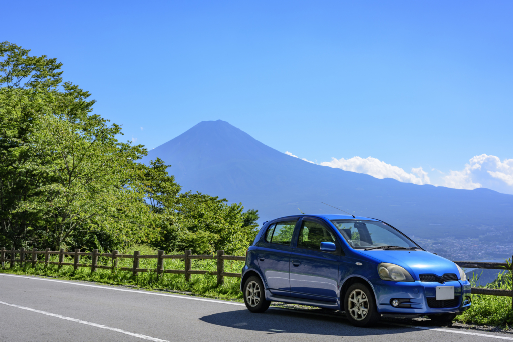 Car on the road with Mt Fuji in background