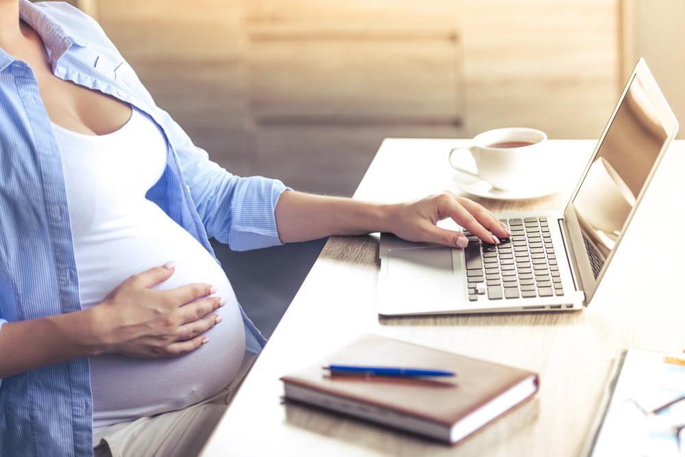 pregnant woman at computer