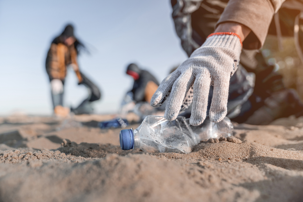 Cleaning trash on beach