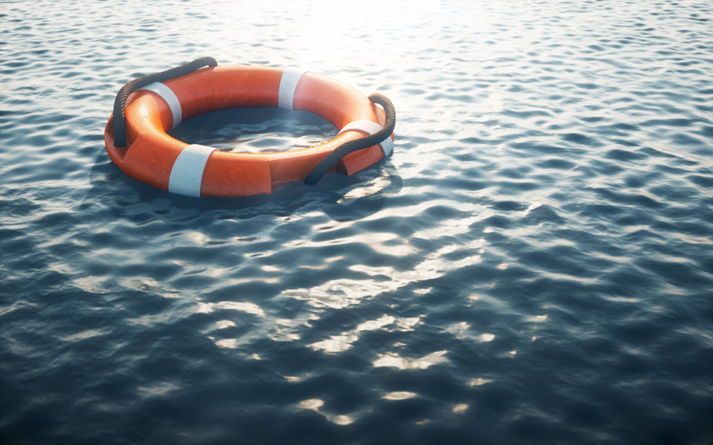Dingy floating in water
