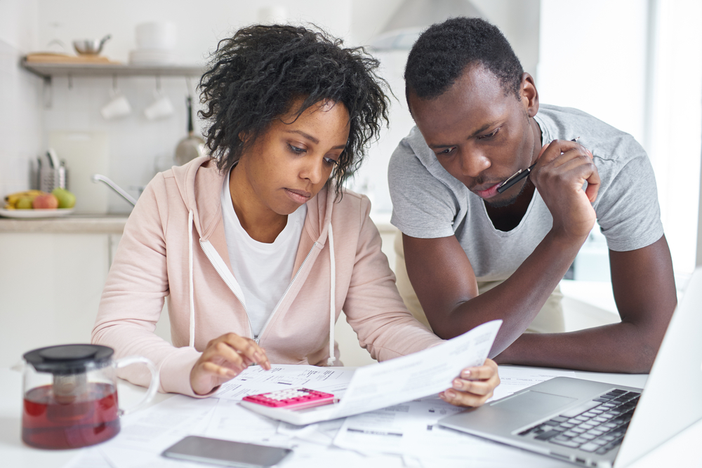Young couple doing paperwork