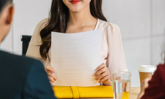 woman presenting her resume at interview